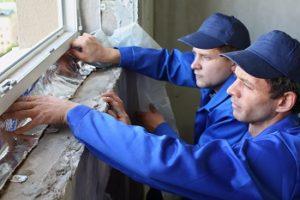 Two men working on replacing windows